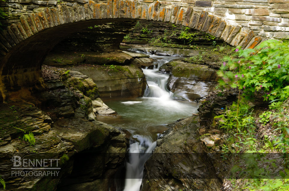 Waterfall framed by a bridge